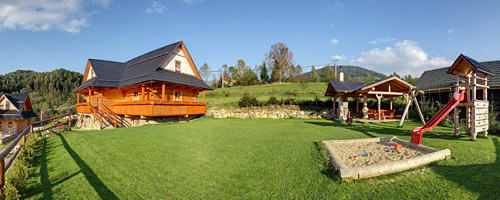 Chalet Ilcik's area with children's playground and barbecue